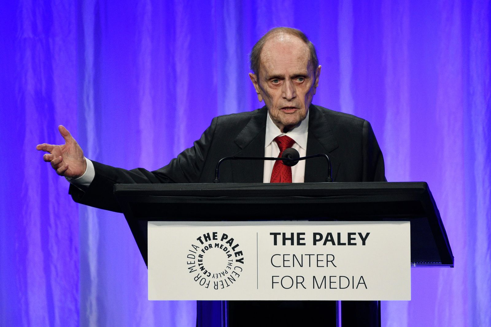 "Honoree Bob Newhart addresses the audience at ""The Paley Honors: A Special Tribute to Television's Comedy Legends"" at the Beverly Wilshire Hotel, Thursday, Nov. 21, 2019, in Beverly Hills, Calif. (Photo by Chris Pizzello/Invision/AP)"