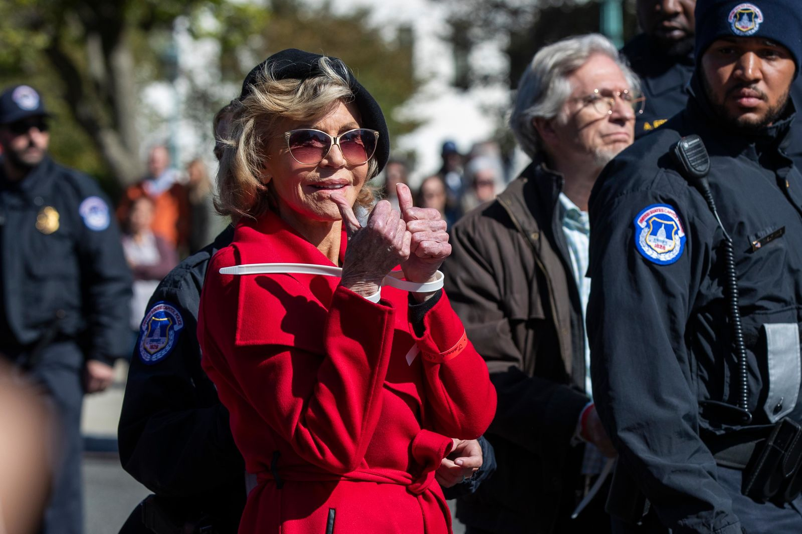 Actress Jane Fonda gestures after being arrested during a rally on Capitol Hill in Washington, Friday, Oct. 18, 2019. A half-century after throwing her attention-getting celebrity status into Vietnam War protests, Fonda is now doing the same in a U.S. climate movement where the average age is 18. (AP Photo/Manuel Balce Ceneta)