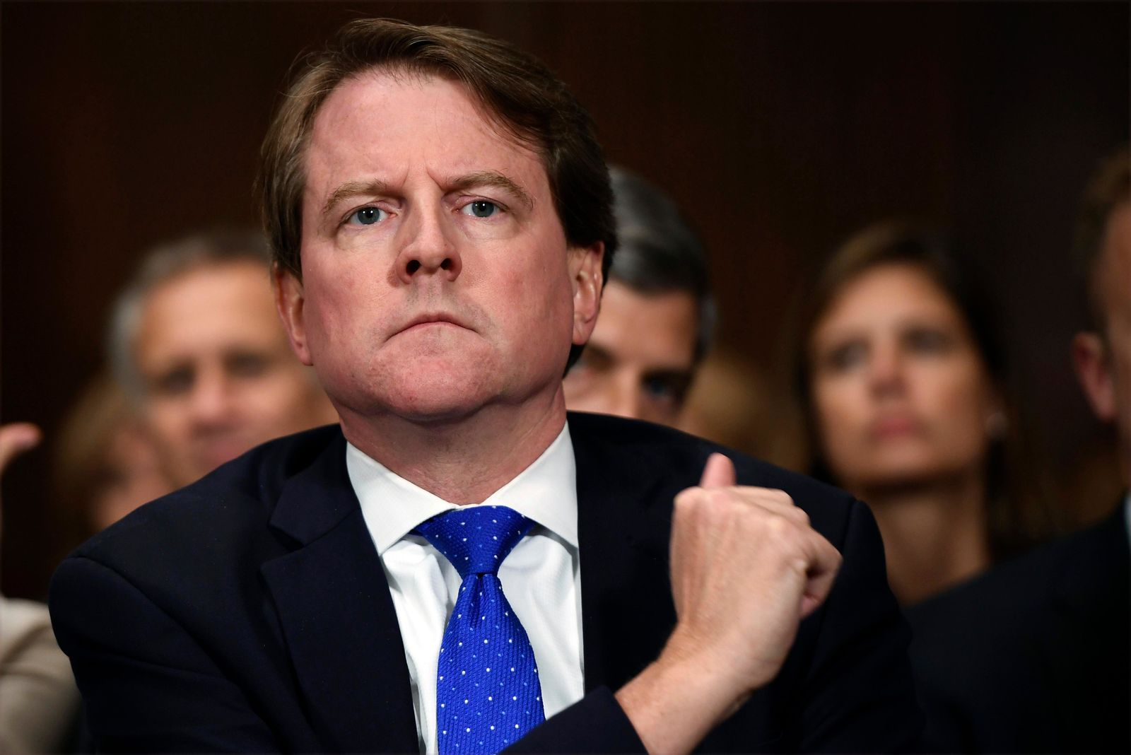 FILE - In this Sept. 27, 2018, file photo, White House counsel Don McGahn listens as Supreme court nominee Brett Kavanaugh testifies before the Senate Judiciary Committee on Capitol Hill in Washington. (Saul Loeb/Pool Photo via AP, File)