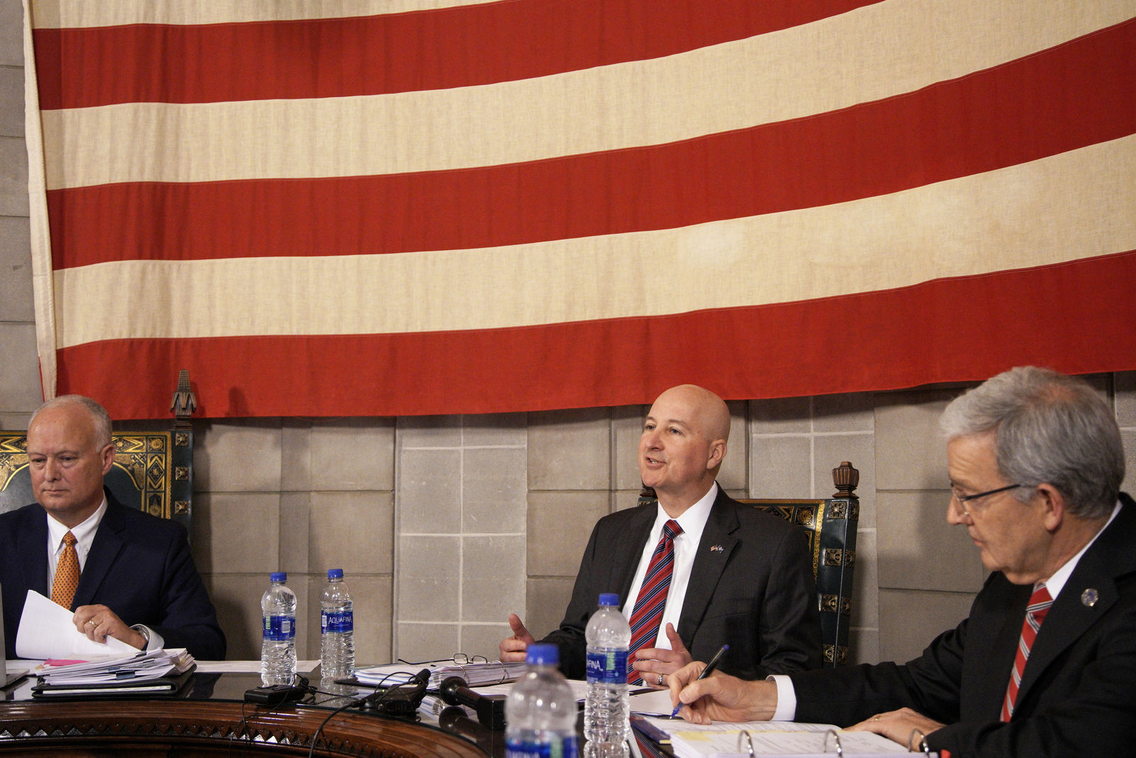 Neb. Gov. Pete Ricketts, center, resides over the Board of Pardons in Lincoln, Neb., Tuesday, Feb. 18, 2020, with Neb. Sect. of State Robert Evnen, right, and Neb. Attorney General Doug Peterson, left, to consider a request for clemency from Caril Ann Clair, the 76-year-old former girlfriend of Charles Starkweather, who went on an infamous killing spree in Nebraska and Wyoming in the late 1950s. The pardon board voted 3-0 to deny the application from Caril Ann Fugate, even though some relatives of Starkweather's victims lobbied in her favor. (AP Photo/Nati Harnik)