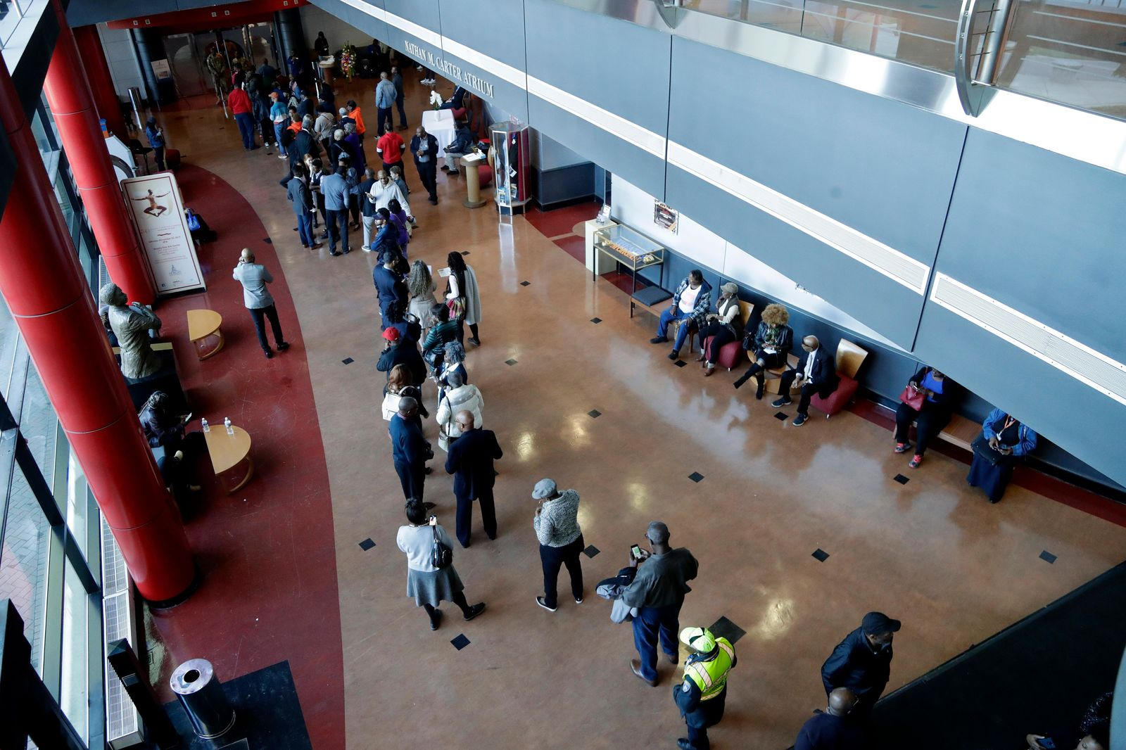 People line up outside of Gilliam Concert Hall as they wait to see the open casket of U.S. Rep. Elijah Cummings during a viewing at Morgan State University, Wednesday, Oct. 23, 2019, in Baltimore. (AP Photo/Julio Cortez)