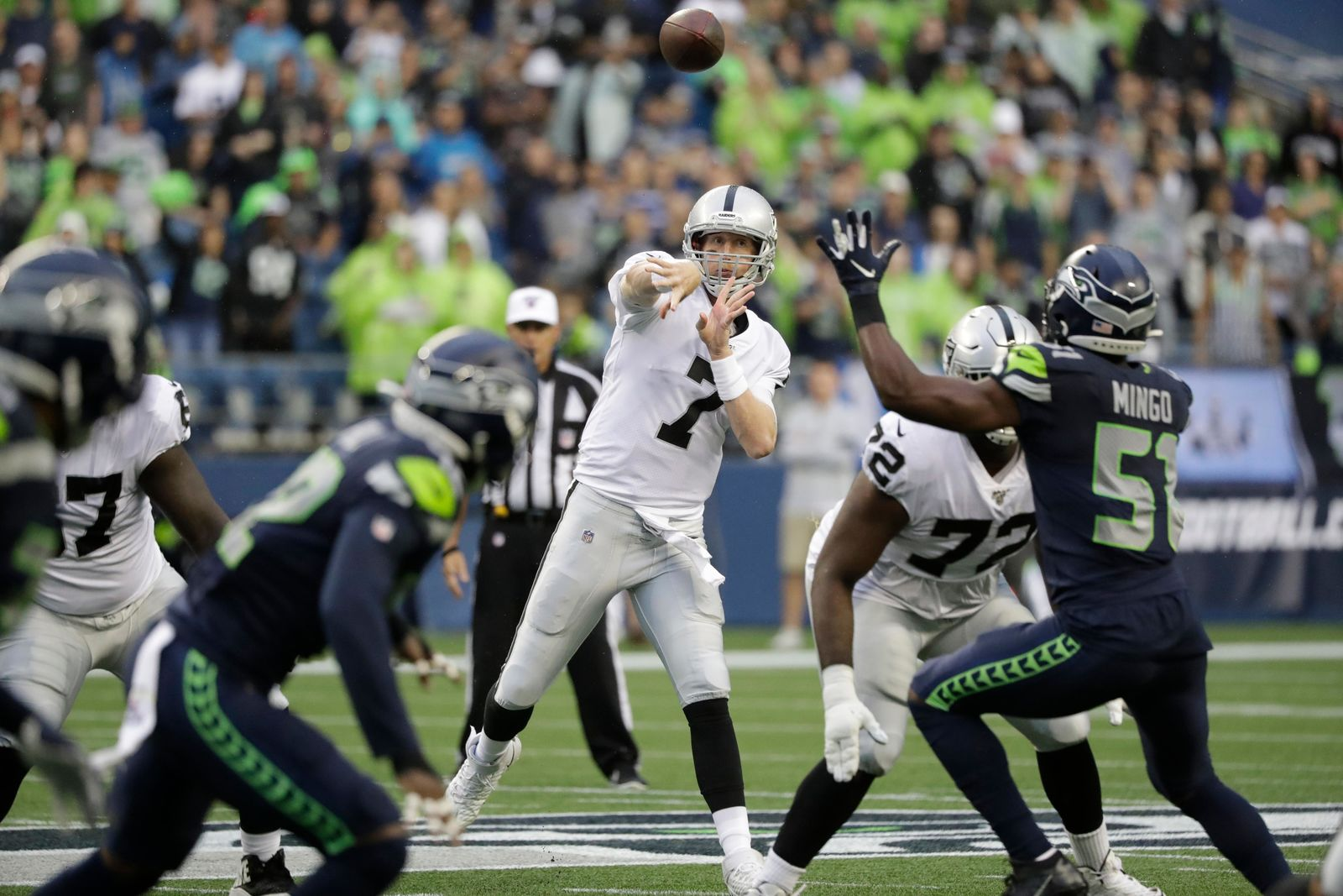 Oakland Raiders quarterback Mike Glennon (7) passes against the Seattle Seahawks during the first half of an NFL football preseason game Thursday, Aug. 29, 2019, in Seattle. (AP Photo/Elaine Thompson)