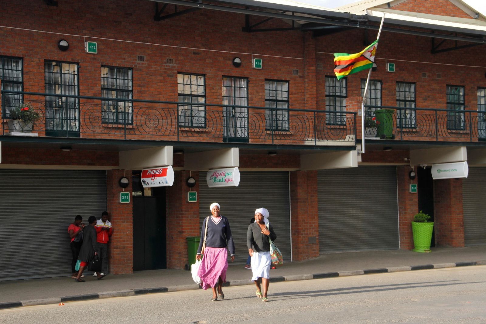 The Zimbabwean flag flies at half-mast on a street in Harare, Saturday, Sept. 7, 2019. Zimbabwe's former leader Robert Mugabe, who ruled for 37 years after independence from white minority rule in 1980, has died at the age of 95. (AP Photo/Tsvangirayi Mukwazhi)