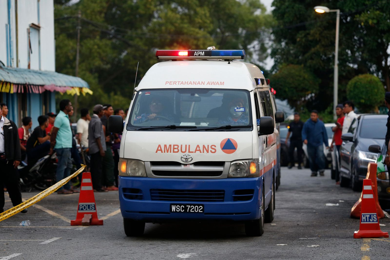 An ambulance transporting the body of a Caucasian female, arrives at a hospital morgue in Seremban, Negeri Sembilan, Malaysia, Tuesday, Aug. 13, 2019.{ } (AP Photo/Lai Seng Sin)