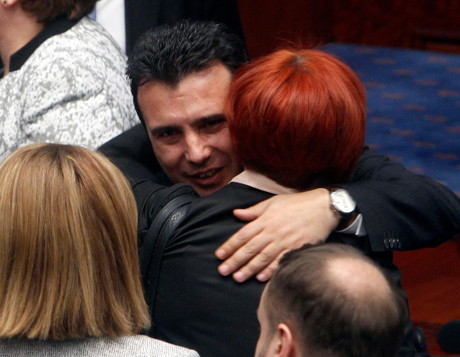 Macedonian Prime Minister Zoran Zaev is greeted by lawmakers after the parliament voted in favor of the constitutional changes, in Macedonian Parliament in the capital Skopje, Friday, Jan. 11, 2019. (AP Photo/Boris Grdanoski)
