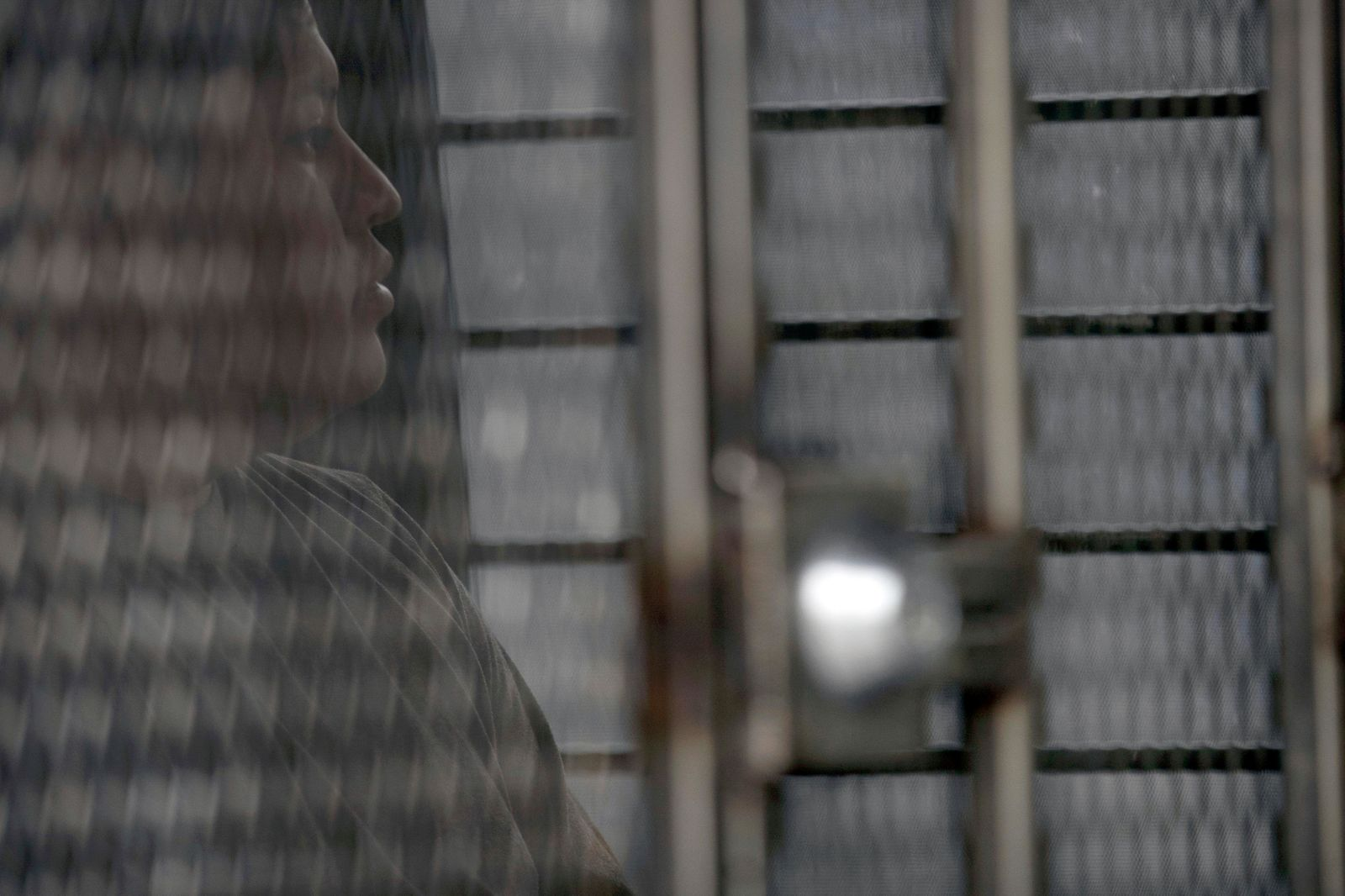 FILE - In this July 8, 2019 file photo, a man in hand and ankle cuffs waits in a van after being detained during a U.S. Immigration and Customs Enforcement (ICE) operation in Escondido, Calif. The administration of President Donald Trump announced Monday, July 22, 2019 that it will vastly expand the authority of immigration officers to deport migrants without allowing them to first appear before judges, its second major policy shift on immigration in eight days. Starting Tuesday, fast-track deportations can apply to anyone in the country illegally for less than two years. (AP Photo/Gregory Bull, File)