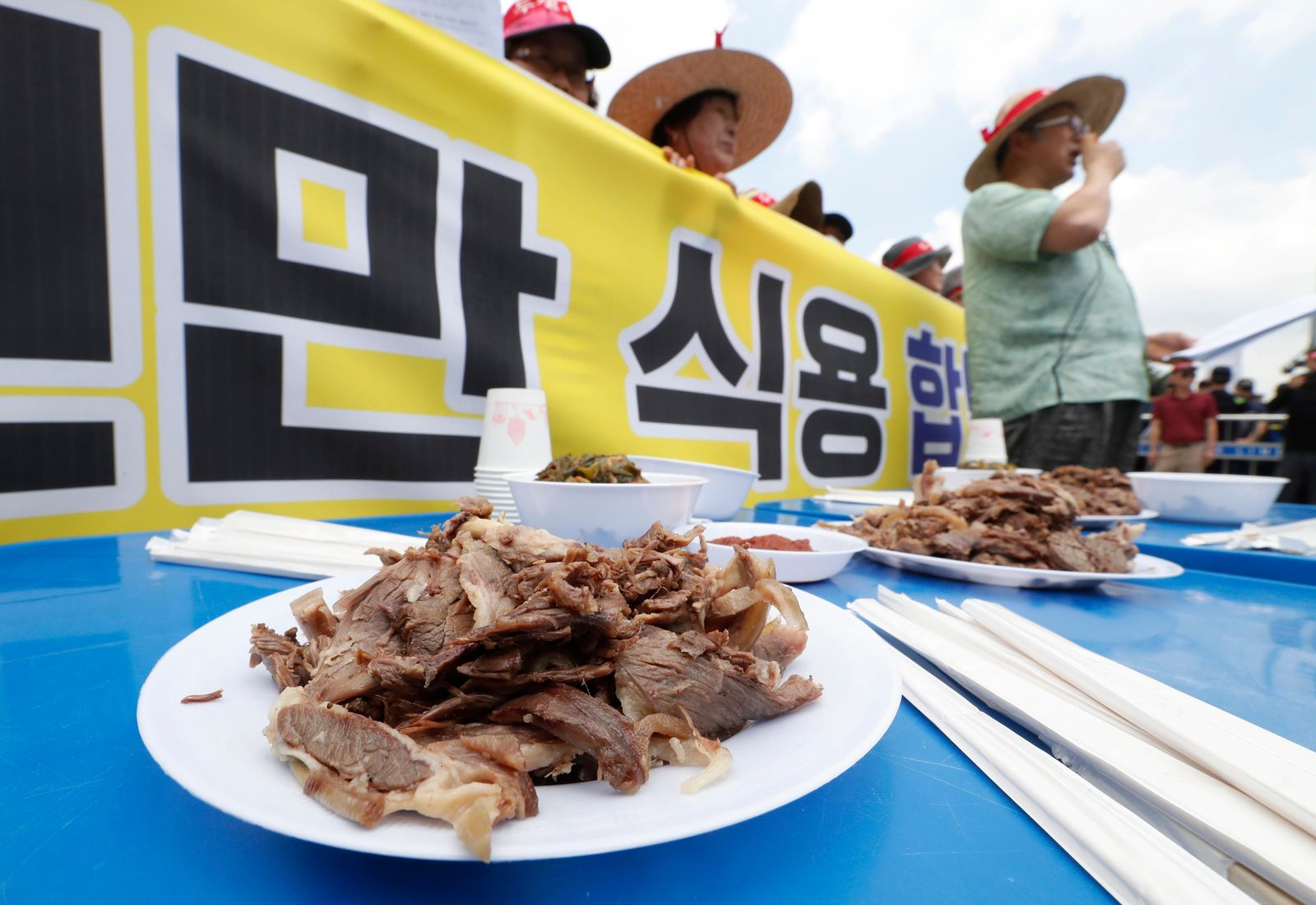 Members of the Korean Dog Meat Association stage a rally to support eating dog meat in front of the National Assembly in Seoul, South Korea, Friday, July 12, 2019. July 12 is the day South Koreans eat healthy foods such as dog meat in the belief it would help them survive heat during summer. (AP Photo/Ahn Young-joon)