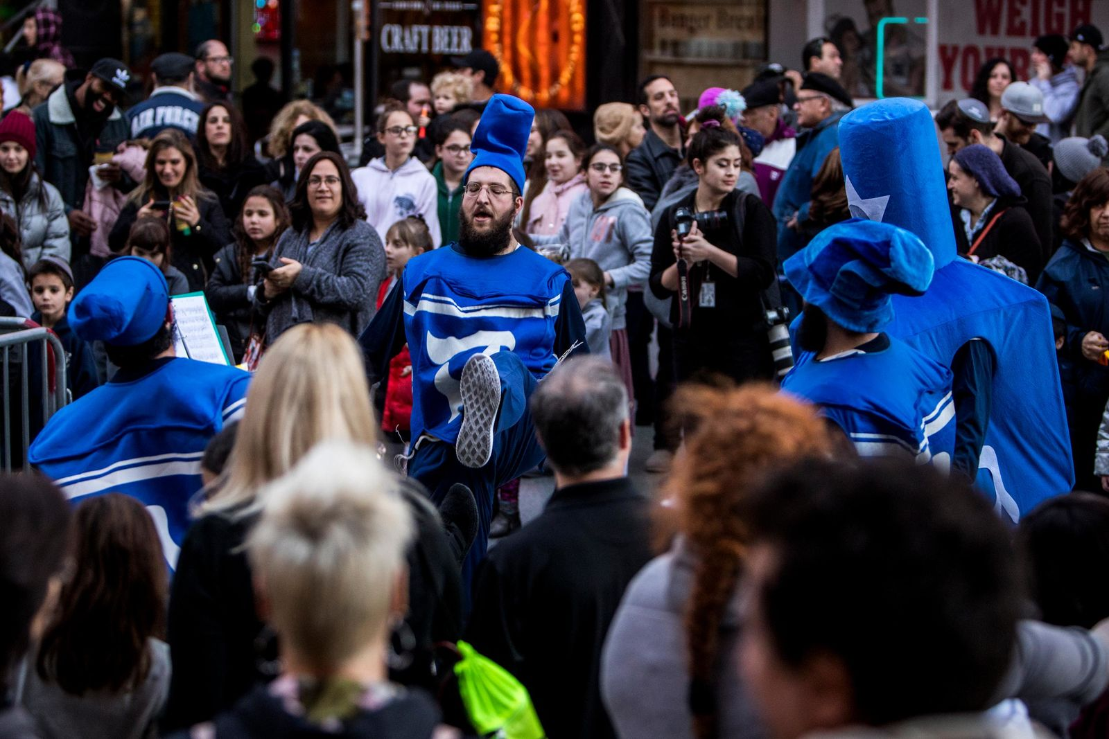 Shlomo Sirota and the dancing menorahs pump up the crowd before the start of the Grand Menorah lighting Sunday, Dec. 2 on Fremont Street. The Grand Menorah will remain on display throughout the Hanukkah season. CREDIT: Joe Buglewicz/Las Vegas News Bureau