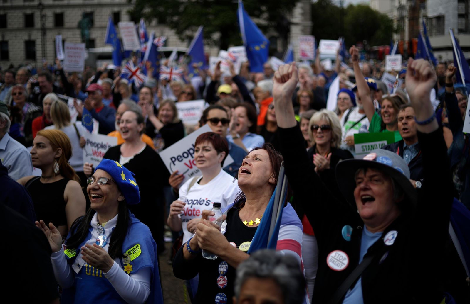 Remain supporters wave EU and Union flags as they demonstrate on Parliament Square in London, Wednesday, Sept. 4, 2019. (AP Photo/Matt Dunham)