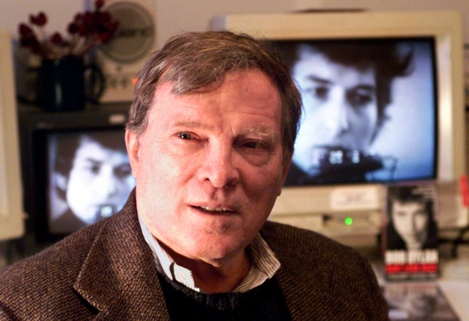 CORRECTS TO FIRST NAME TO FRAZER INSTEAD OF FRANK PENNEBAKER  FILE - In this Jan. 27, 2000 file photo, documentary filmmaker D.A. Pennebaker is flanked by 35-year-old images of Bob Dylan as Pennebaker sits in his New York editing suite. Oscar-winning documentary maker Pennebaker has died at the age of 94. Frazer Pennebaker said in an email his father died Thursday, Aug. 1, 2019, at his Long Island home from natural causes. (AP Photo/Kathy Willens, File)