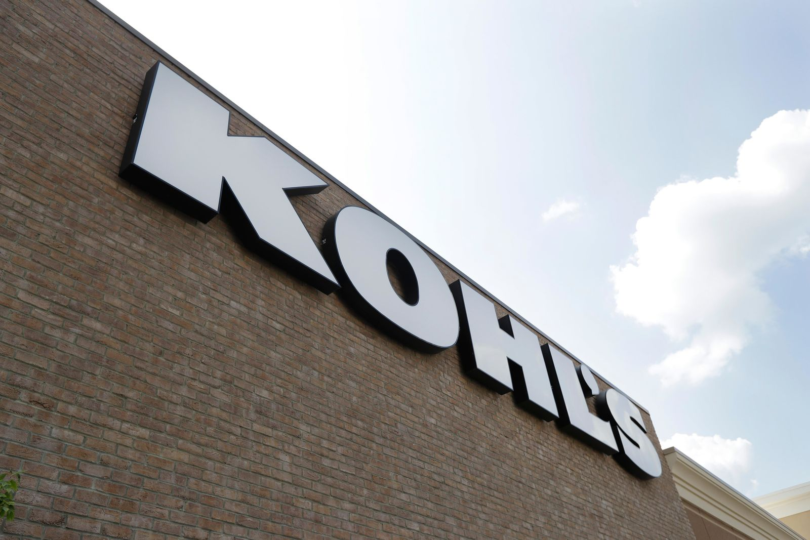 In this Aug. 28, 2018, fie photo, a Kohl's sign is shown in front of a Kohl's store in Concord, N.C. On Thursday, Jan. 10, 2019, Kohl's reported a small sales growth that showed a dramatic slowdown from a year ago. (AP Photo/Chuck Burton, File)