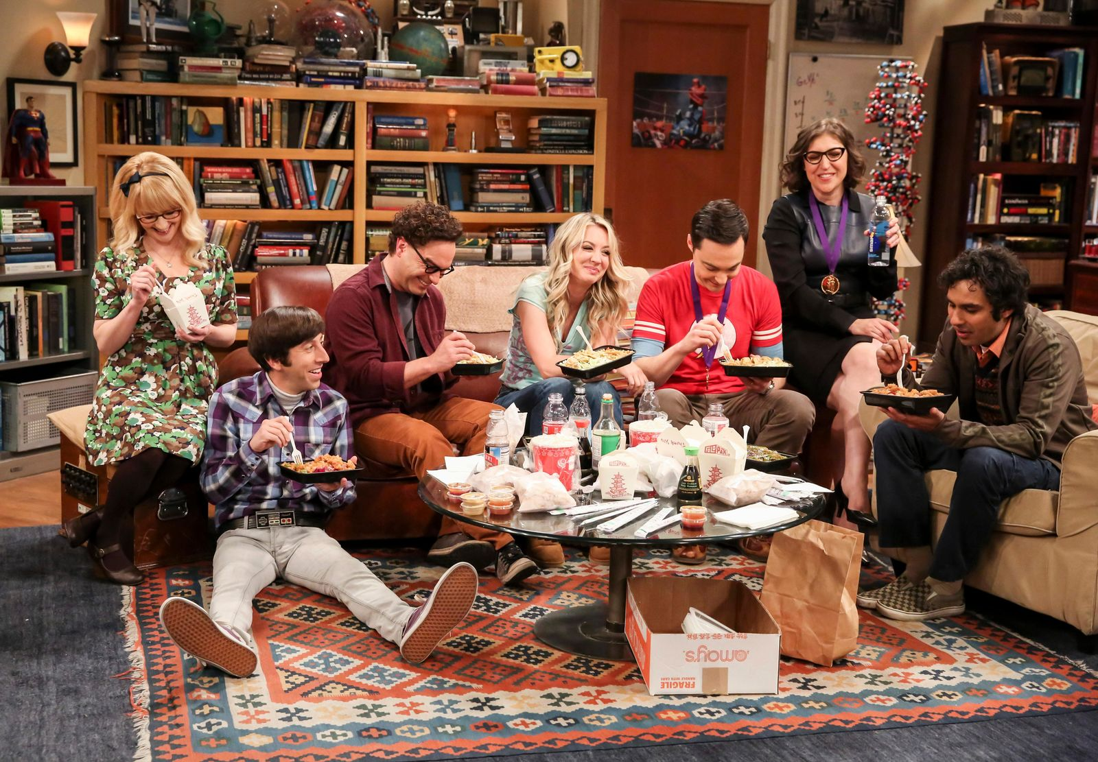 "This photo provided by CBS shows Melissa Rauch, from left, Simon Helberg, Johnny Galecki, Kaley Cuoco, Jim Parsons, Mayim Bialik and Kunal Nayyar in a scene from the series finale of ""The Big Bang Theory,""{ } on the CBS Television Network. (Michael Yarish/CBS via AP)"
