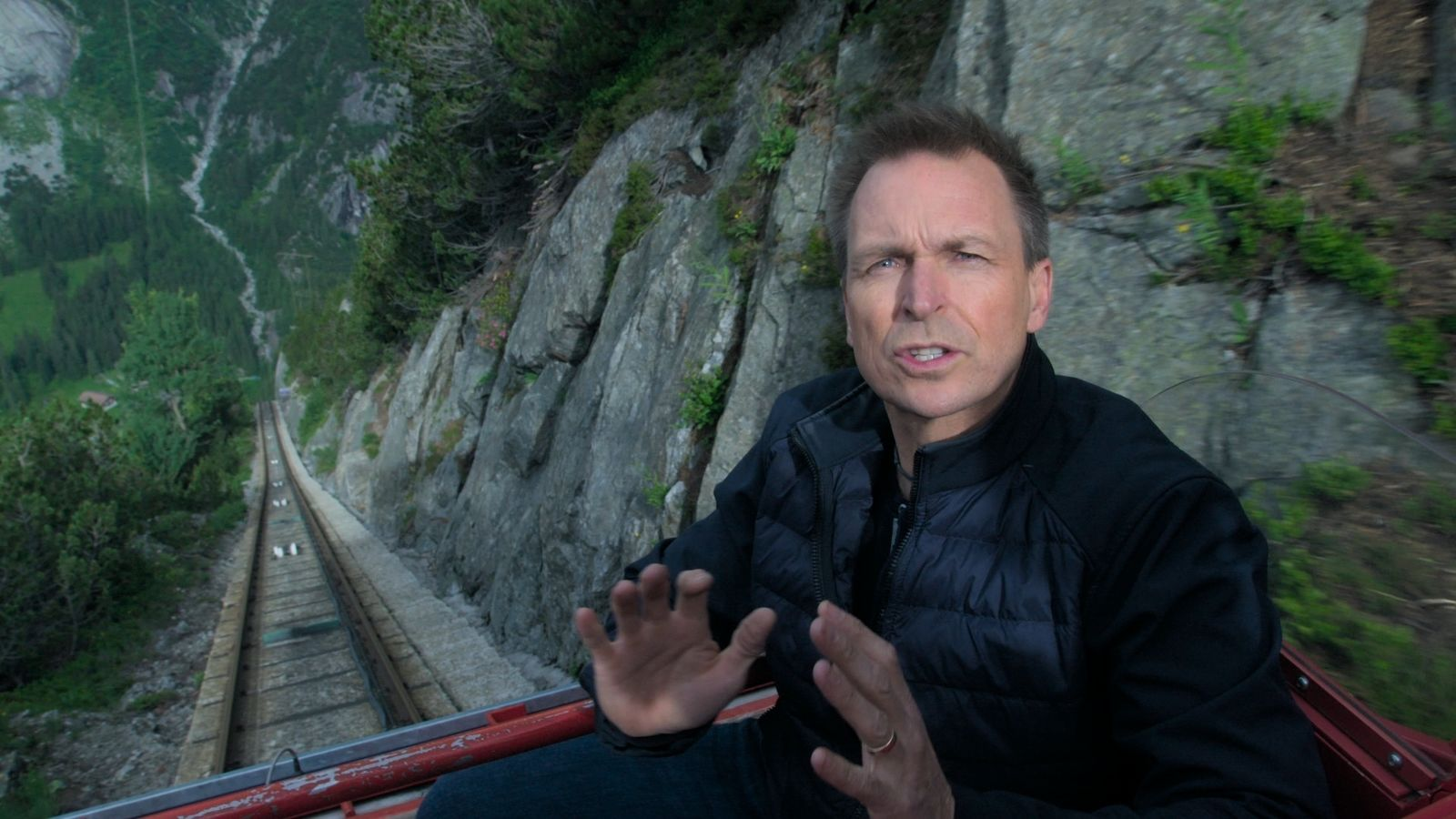 "This image released by CBS shows host Phil Keoghan in a scene from last season's competition series ""The Amazing Race.""{ } (CBS via AP)"