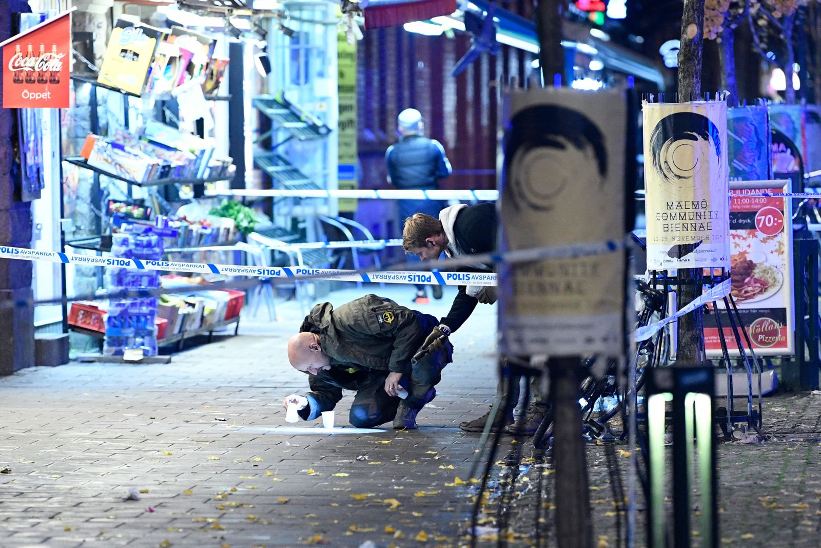 In this photo taken late Saturday, Nov. 9, 2019, a policeman works near the scene of a shooting, in Malmo, Sweden.{ } (Johan Nilsson/TT News Agency via AP)