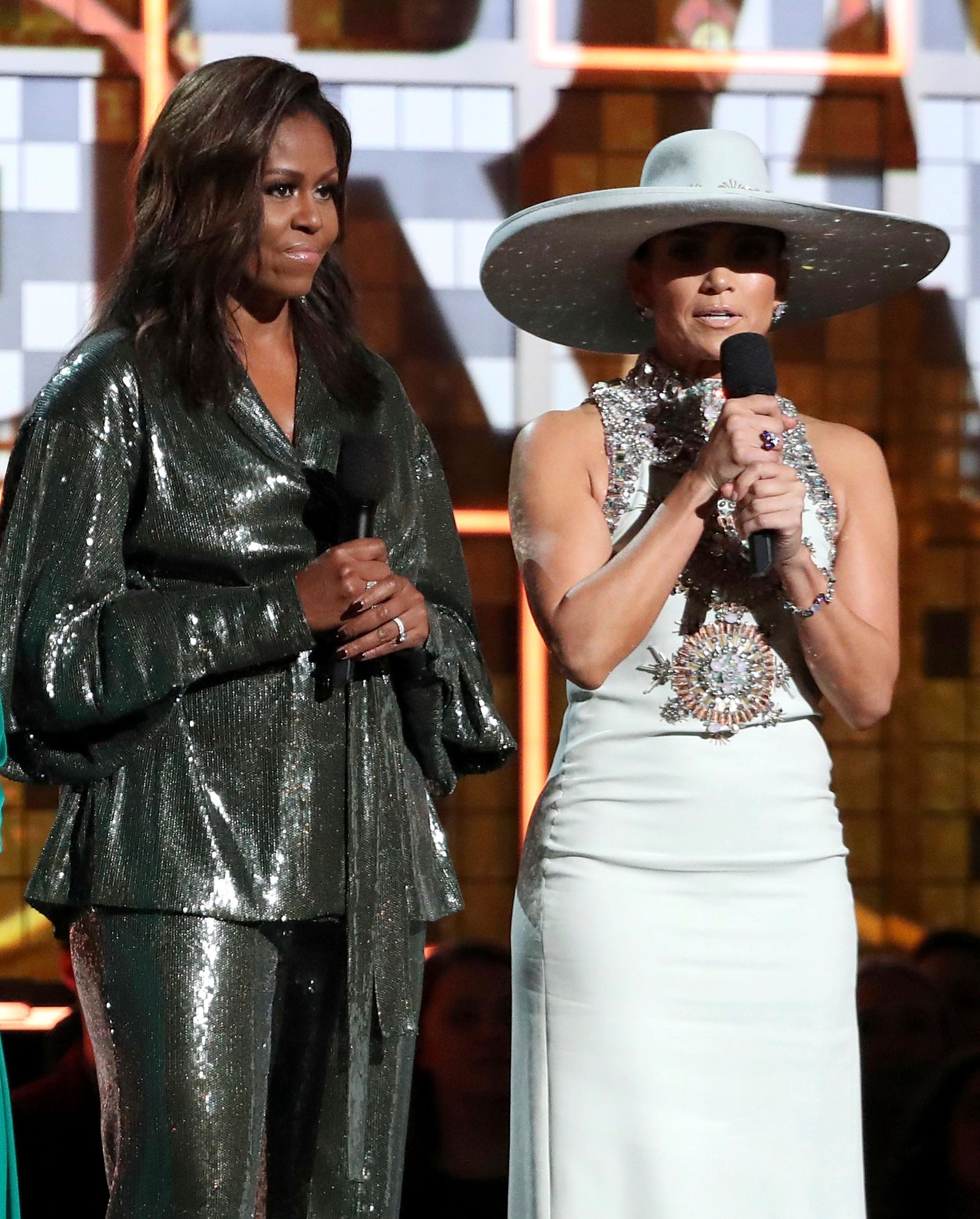 Michelle Obama, left, and Jennifer Lopez speak at the 61st annual Grammy Awards on Sunday, Feb. 10, 2019, in Los Angeles. (Photo by Matt Sayles/Invision/AP)