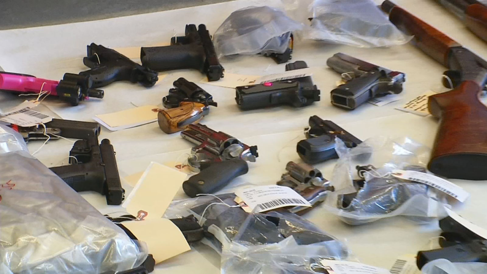 "Guns seized during a bust dubbed, ""Operation{ }Patched Out"" in 2018. (WJAR)"
