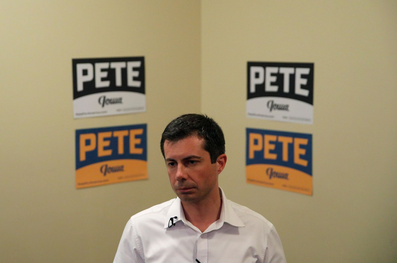 FILE - In this Aug. 15, 2019, file photo, Democratic presidential candidate South Bend Mayor Pete Buttigieg speaks with the media after a campaign event in Ottumwa, Iowa. Buttigieg would like to turn the fight for the 2020 Democratic presidential nomination into a contest about generational change. But there's one looming problem for the 37-year-old mayor of South Bend, Indiana: He has yet to win over his own. (AP Photo/John Locher, file)