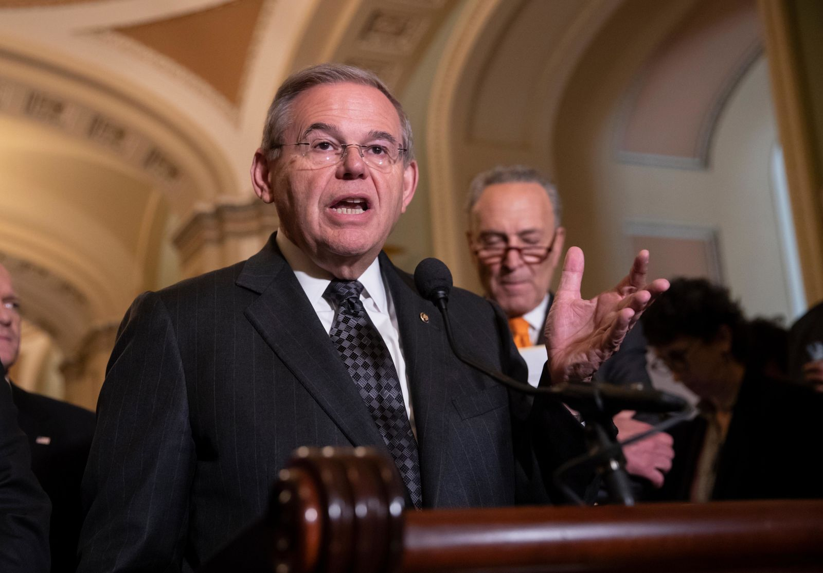 Sen. Bob Menendez, D-N.J., the ranking member of the Senate Foreign Relations Committee, joined at right by Senate Minority Leader Chuck Schumer, D-N.Y., talks to reporters on Capitol Hill in Washington, Tuesday, June 12, 2018. (AP Photo/J. Scott Applewhite)