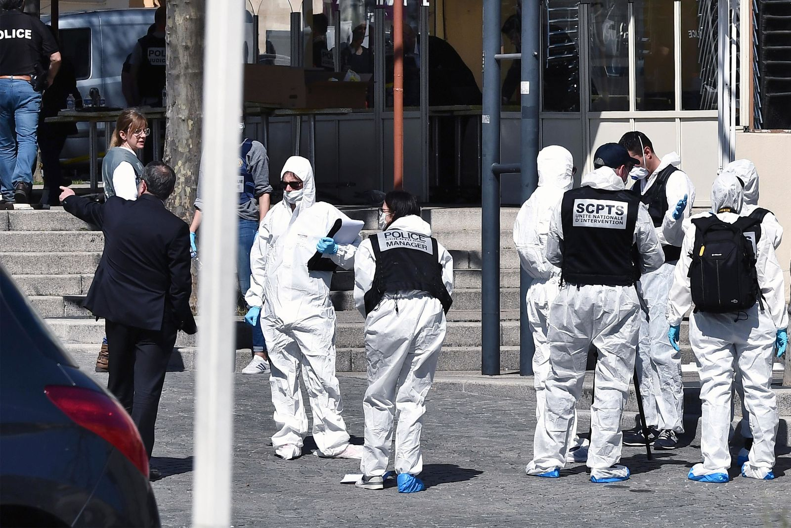 Police officers investigate after a man wielding a knife attacked residents venturing out to shop in the town under lockdown, Saturday April 4, 2020 in Romans-sur-Isere, southern France. (AP Photo)