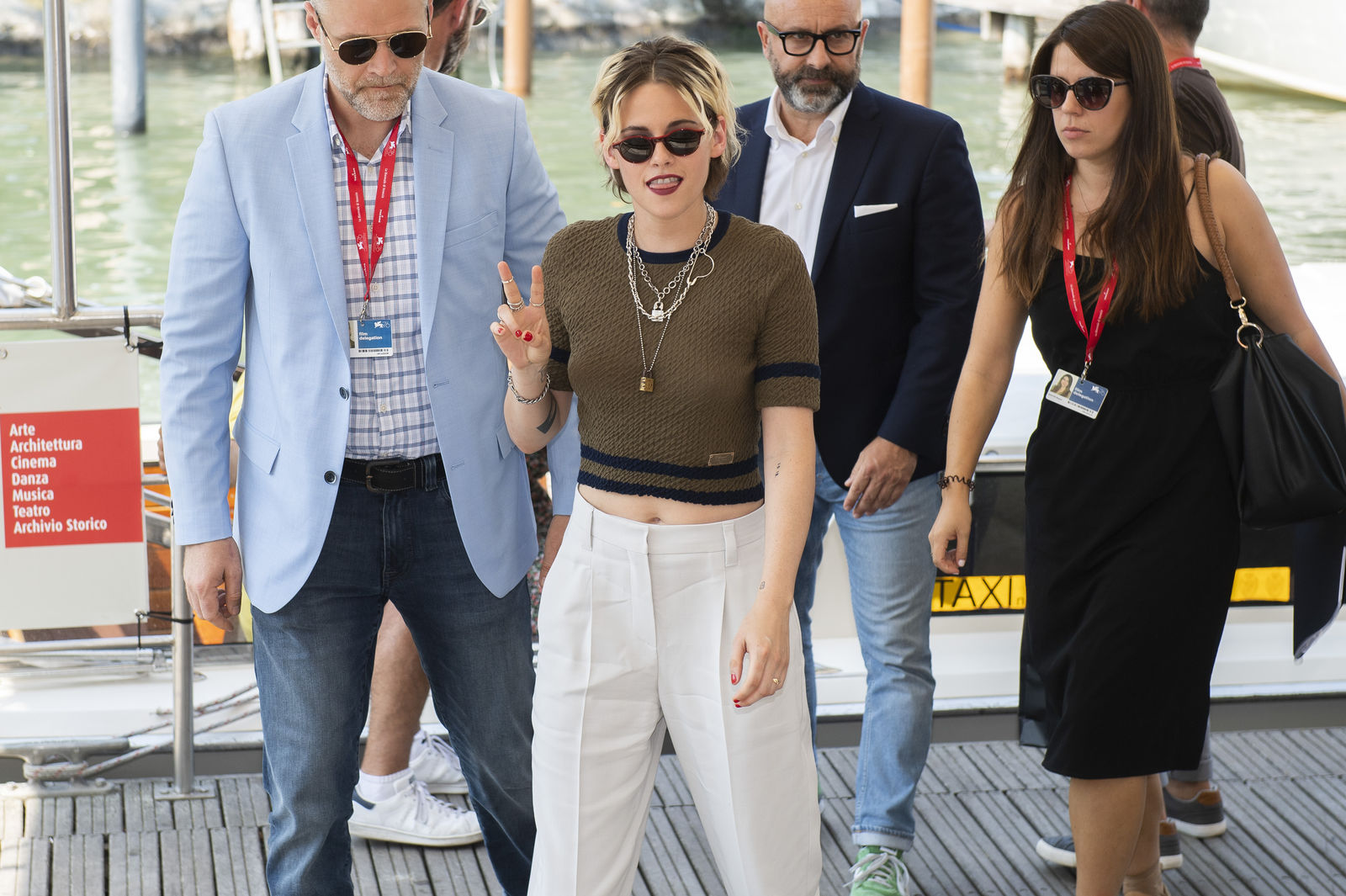 Actress Kristen Stewart gestures to photographers upon arrival for the photo call of the film 'Seberg' at the 76th edition of the Venice Film Festival in Venice, Italy, Friday, Aug. 30, 2019. (Photo by Arthur Mola/Invision/AP)