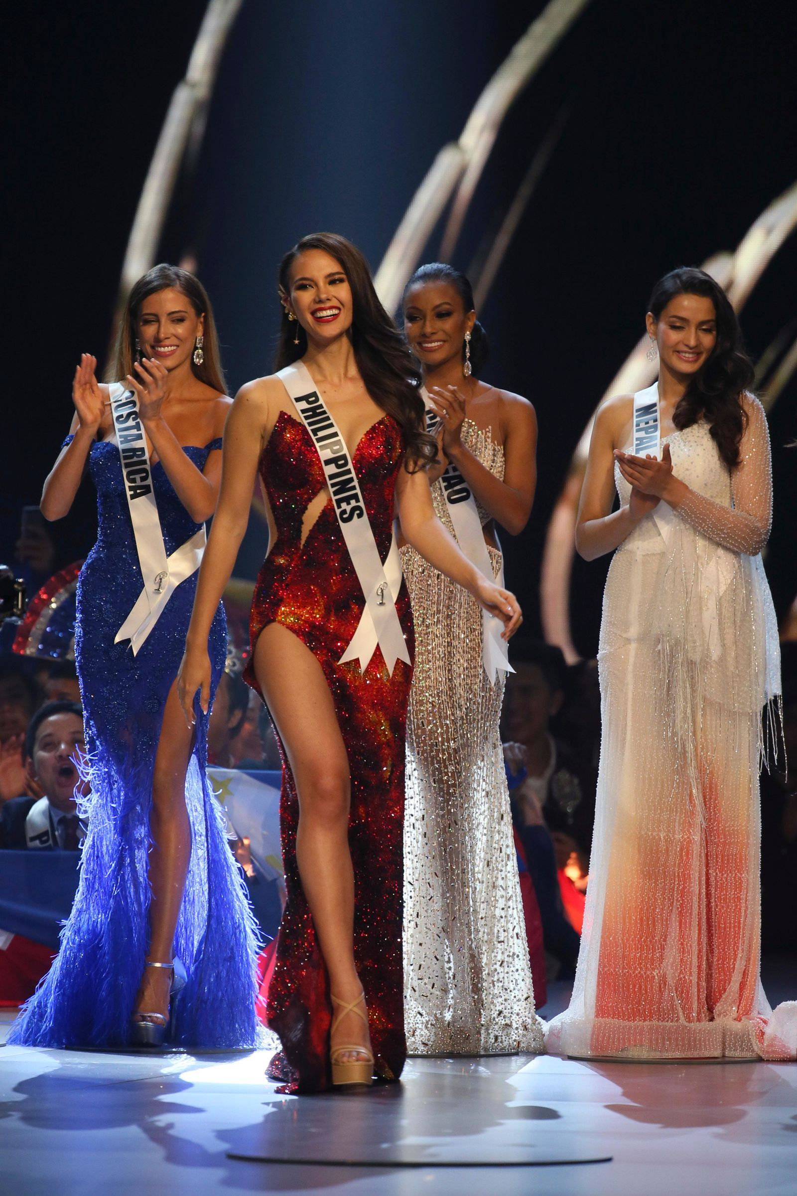Miss Philippines Catriona Gray, second from left, walks on the stage during the final of 67th Miss Universe competition in Bangkok, Thailand, Monday, Dec. 17, 2018.(AP Photo/Gemunu Amarasinghe)
