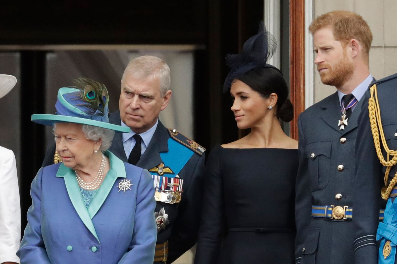 "FILE - In this Tuesday, July 10, 2018 file photo Britain's Queen Elizabeth II, Prince Andrew, Meghan the Duchess of Sussex and Prince Harry stand on a balcony to watch a flypast of Royal Air Force aircraft pass over Buckingham Palace in London. As part of a surprise announcement distancing themselves from the British royal family, Prince Harry and his wife Meghan declared they will ""work to become financially independent"" _ a move that has not been clearly spelled out and could be fraught with obstacles. (AP Photo/Matt Dunham, File)"