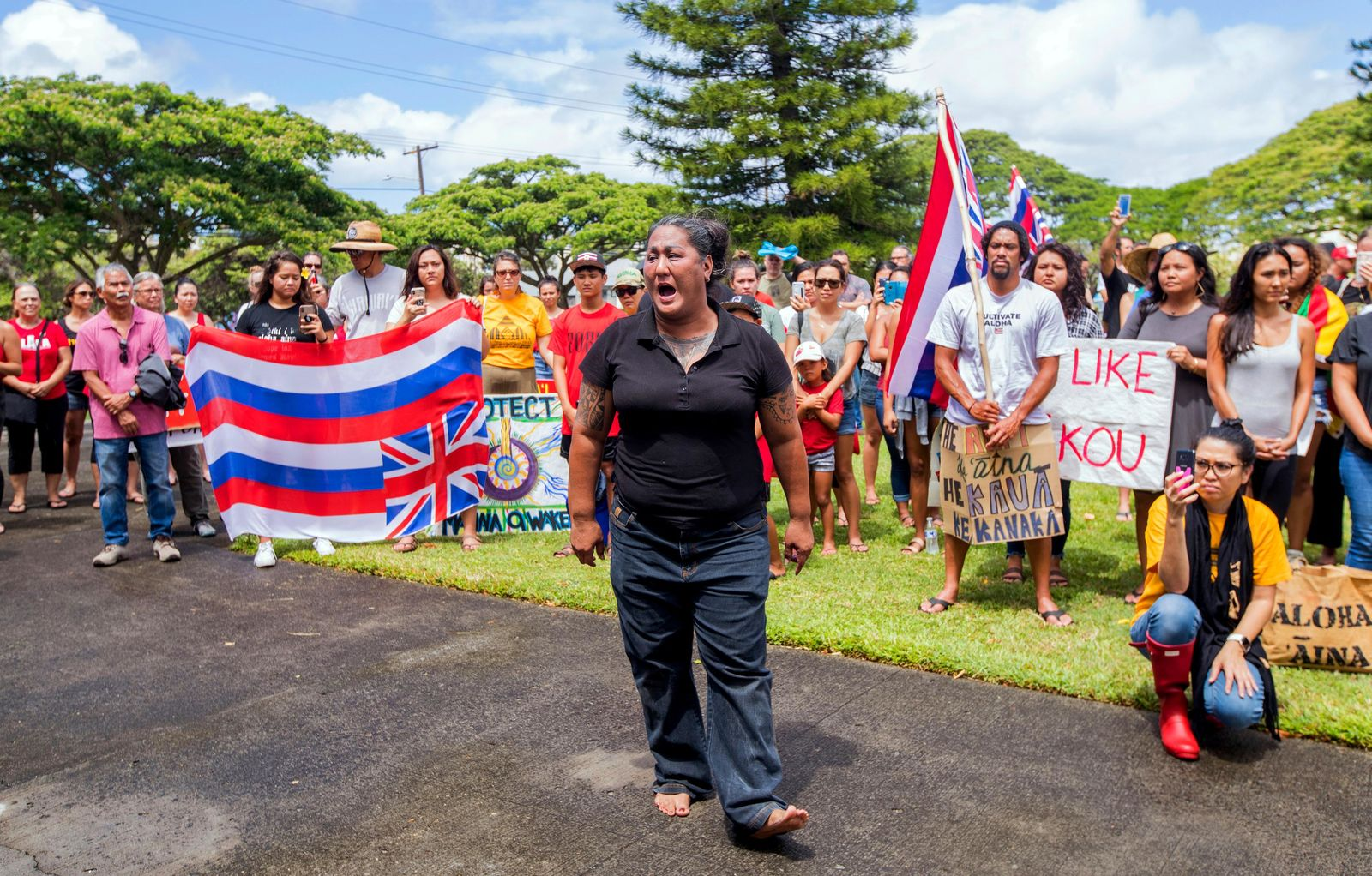 Kumu (teacher) Hinaleimoana Wong-Kalu performs a chant before meeting with University of Hawaii at Manoa President David Lassner on the campus in Honolulu Friday, July 19, 2019. All are protesting the construction of the Thirty Meter Telescope on Mauna Kea on the Big Island of Hawaii. (Dennis Oda/Honolulu Star-Advertiser via AP)