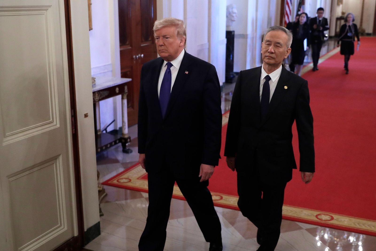 President Donald Trump arrives with Chinese Vice Premier Liu He to sign a trade agreement in the East Room of the White House, Wednesday, Jan. 15, 2020, in Washington. (AP Photo/Evan Vucci)