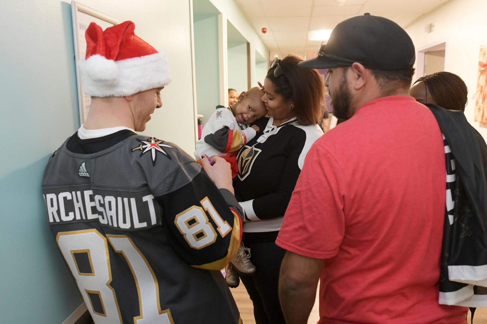 Izzy Woodward, held by her mother Tierra Woodward, acts coy while meeting her favorite player, Jonathan Marchessault, during the Vegas Golden Knights visit to Summerlin Hospital Friday, December 21, 2018. CREDIT: Sam Morris/Las Vegas News Bureau