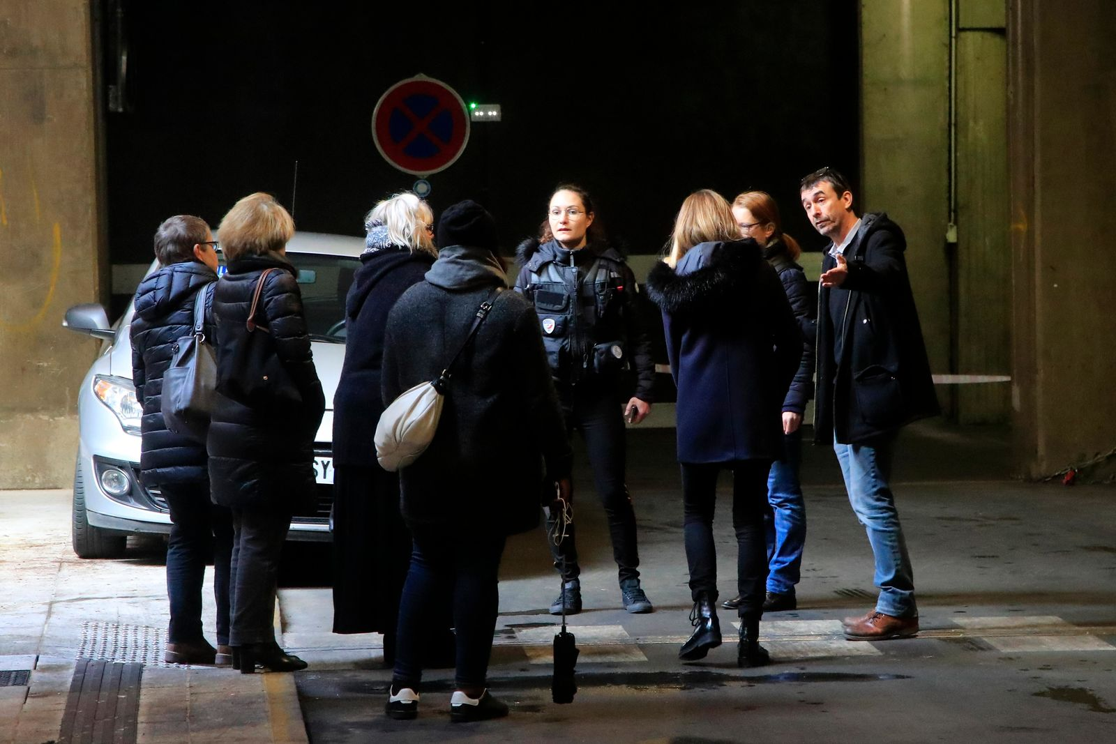 Investigative police officers discuss in a tunnel under Le Defense business district after a man threatened officers Friday, Dec.13, 2019 in Paris.{ } (AP Photo/Michel Euler)