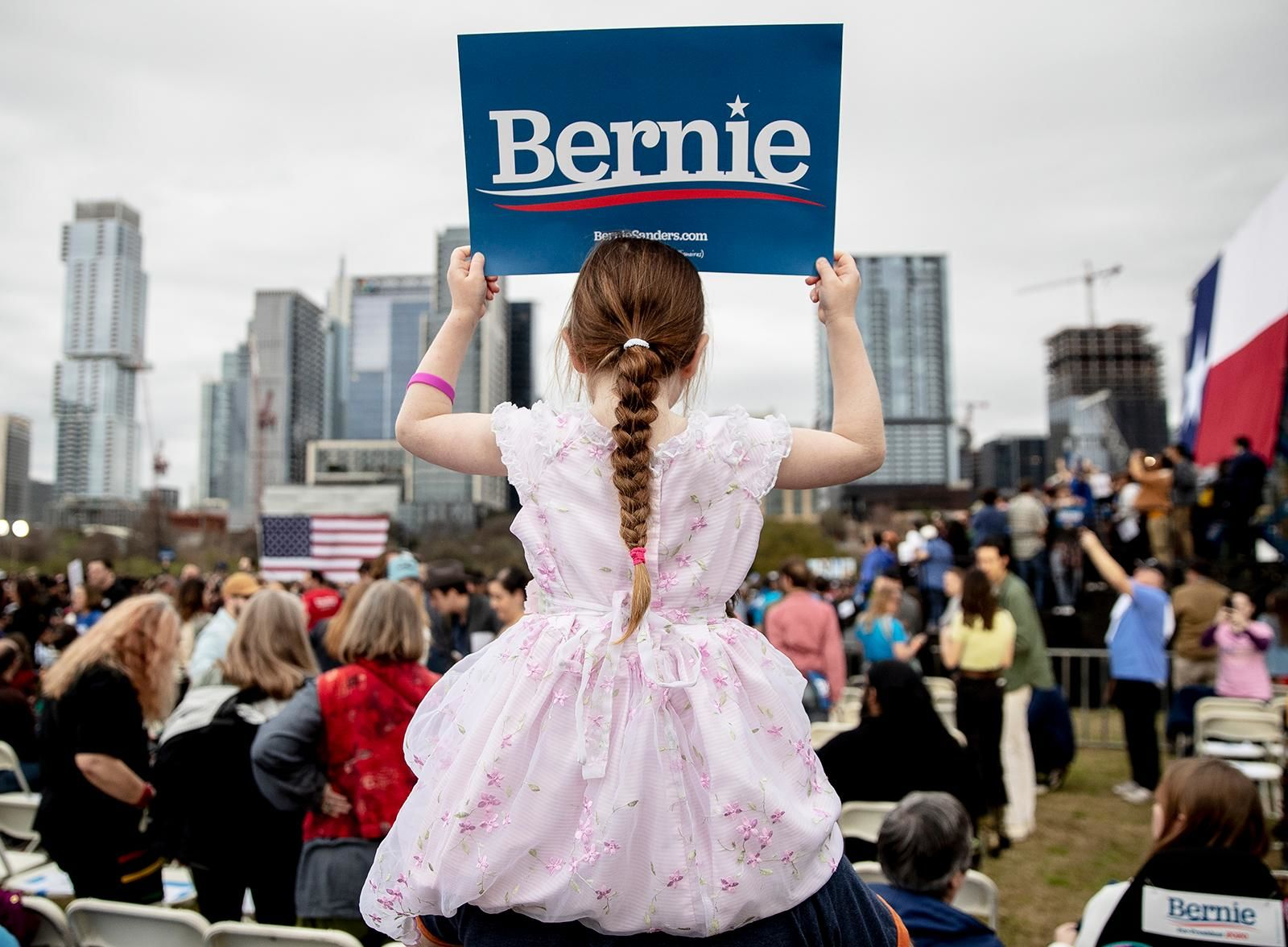 Lily Barbour, 5, holds up a campaign sign for Democratic presidential candidate Sen. Bernie Sanders, I-Vt., during a campaign event in Austin, Texas, Sunday, Feb. 23, 2020. (Nick Wagner/Austin American-Statesman via AP)