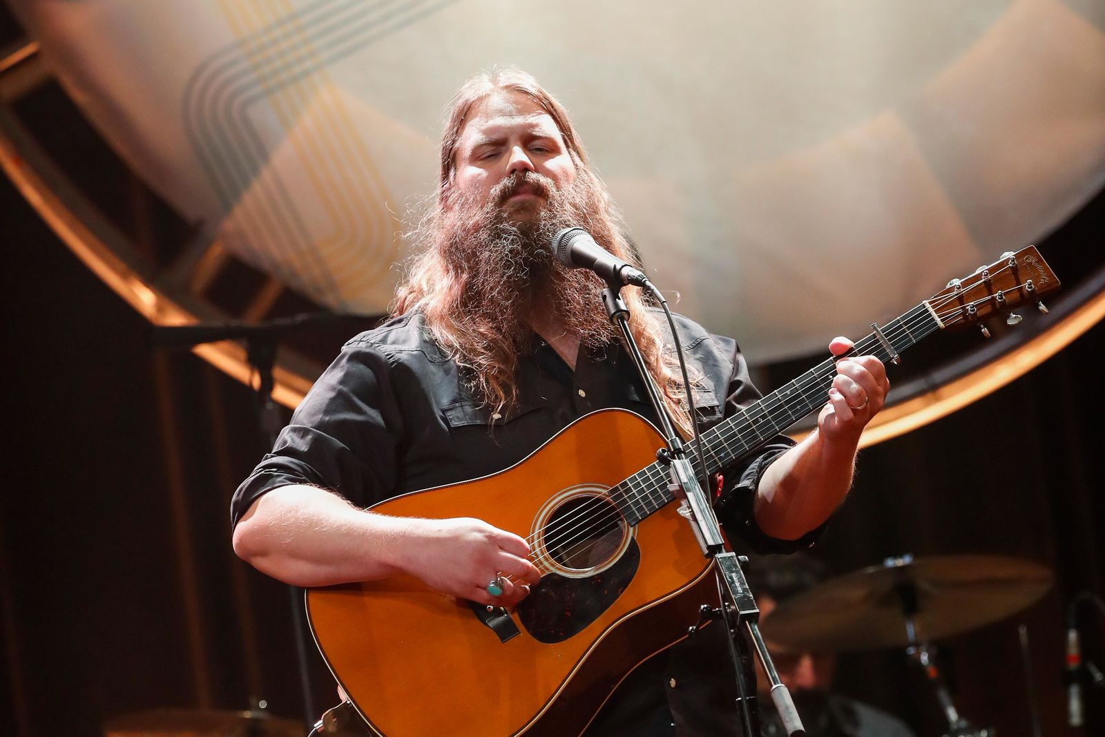 FILE - In this Aug. 22, 2018, file photo, Chris Stapleton performs at the 12th Annual ACM Honors at the Ryman Auditorium in Nashville, Tenn.{ } (Photo by Al Wagner/Invision/AP, File)