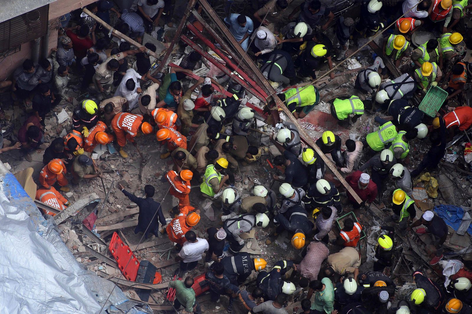 Rescuers work at the site of a building that collapsed in Mumbai, India, Tuesday, July 16, 2019.{ } (AP Photo/Rajanish Kakade)
