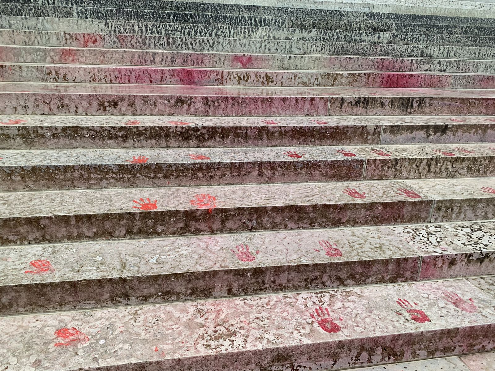 Red handprints on the Ohio Statehouse steps. (Courtesy: Ohio State Highway Patrol)<p></p>