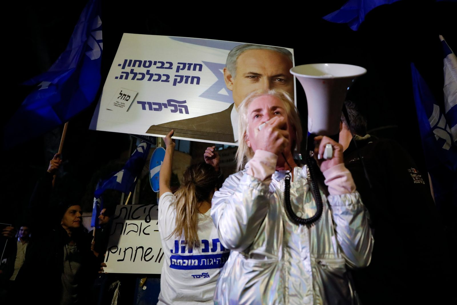Supporters of Israeli Prime Minister Benjamin Netanyahu gather outside his residence in Jerusalem, Thursday, Nov. 21, 2019.{ } (AP Photo/Ariel Schalit)