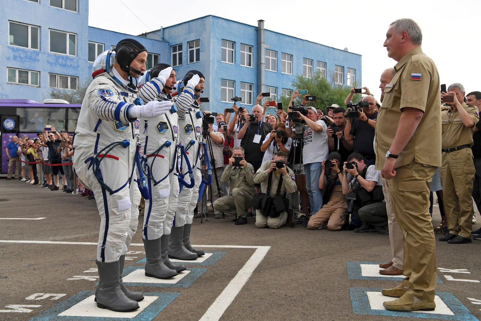 From left: U.S. astronaut Andrew Morgan, Russian cosmonaut Alexander Skvortsov and Italian astronaut Luca Parmitano, members of the main crew of the expedition to the International Space Station (ISS), report to head or Russian space agency Dmitry Rogozin prior the launch of Soyuz MS-13 space ship at the Russian leased Baikonur cosmodrome, Kazakhstan, Saturday, July 20, 2019. (AP Photo/Kirill Kudryavtsev, Pool)