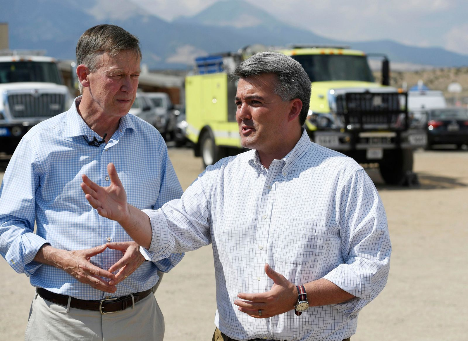 U.S. Sen. Cory Gardner, R-Colo., right, responds to a question as Colorado Gov. John Hickenlooper listens during a press conference about the Spring Creek Fire at the Sierra Grande School grounds Friday, July 6, 2018, in Fort Garland, Colo. (Andy Cross /The Denver Post via AP)