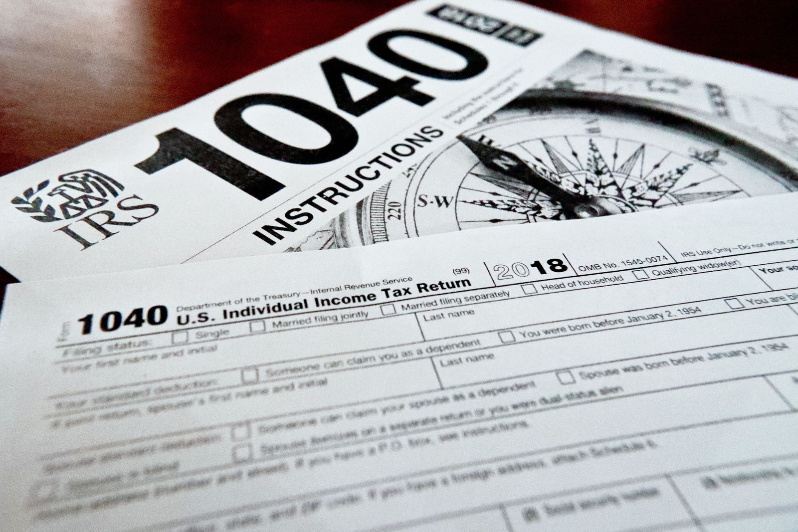 FILE- This Feb. 13, 2019, file photo shows multiple forms printed from the Internal Revenue Service web page that are used for 2018 U.S. federal tax returns.{ } { }(AP Photo/Keith Srakocic, File)
