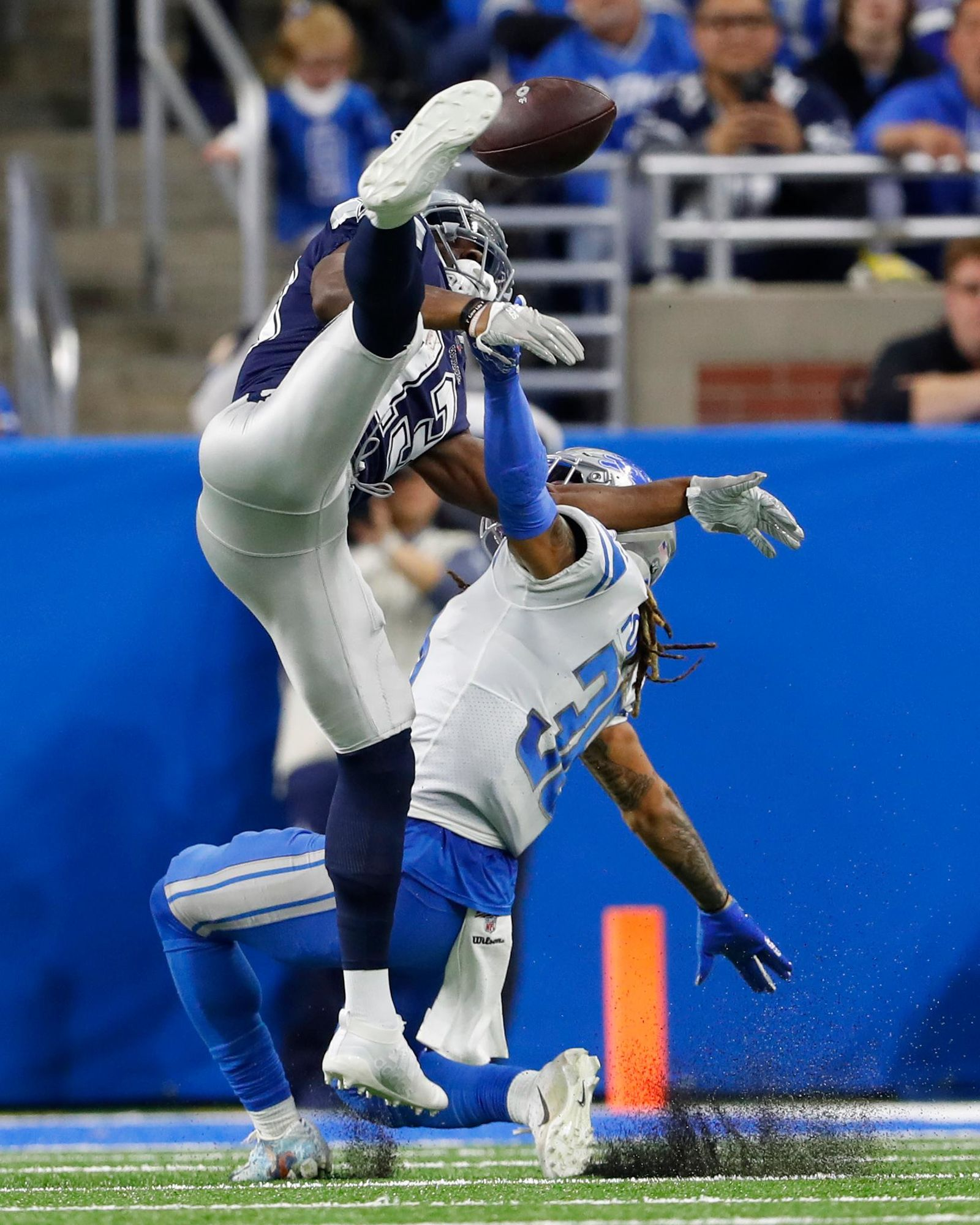 Detroit Lions defensive back Mike Ford (38) interferes with Dallas Cowboys wide receiver Michael Gallup (13) during the first half of an NFL football game, Sunday, Nov. 17, 2019, in Detroit. (AP Photo/Paul Sancya)