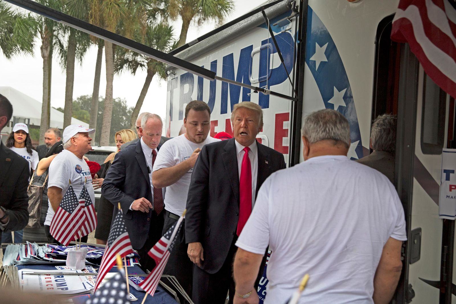 In an Aug. 24, 2016 photo, Republican presidential nominee Donald Trump meets supporters organizing voter registration and support for his campaign just before a rally at the Florida State Fairgrounds in Tampa, Fla. (Loren Elliott/Tampa Bay Times via AP)