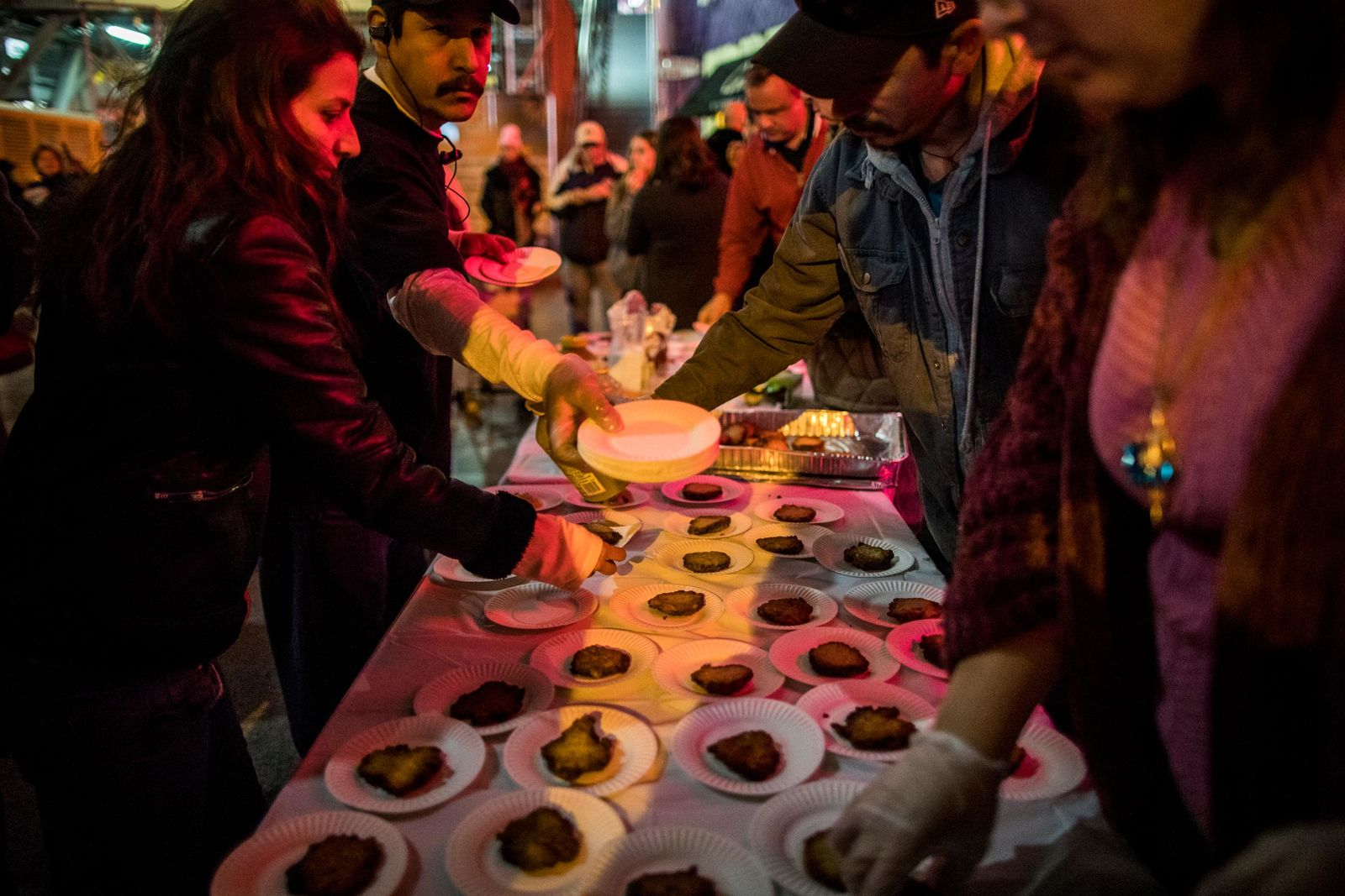 Latkes are handed out after the lighting of the Grand Menorah in downtown Las Vegas on Sunday, Dec. 2. The ceremony featured a 20-foot Grand Menorah, which will remain on display throughout the Hanukkah season. CREDIT: Joe Buglewicz/Las Vegas News Bureau