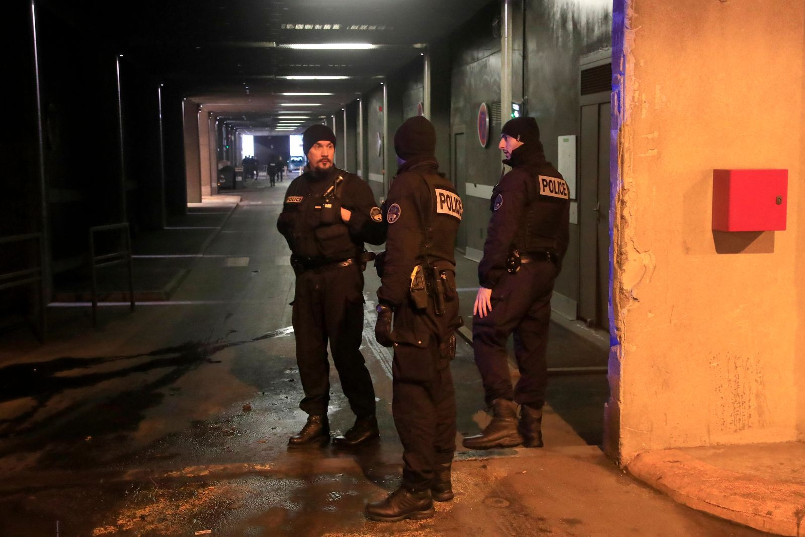 "Police officers patrol in a tunnel under La Defense business district after a man threatened officers Friday, Dec.13, 2019 in Paris. Paris police say officers ""neutralized"" a man who threatened officers with a knife Friday morning in the French capital's main business district. (AP Photo/Michel Euler)"