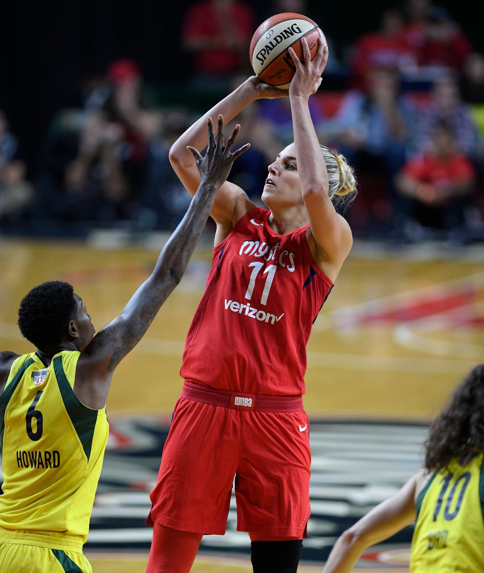 FILE - In this Sept. 12, 2018, file photo, Washington Mystics forward Elena Delle Donne (11) shoots against Seattle Storm forward Natasha Howard (6) during the second half of Game 3 of the WNBA basketball finals, in Fairfax, Va. (AP Photo/Nick Wass, File)