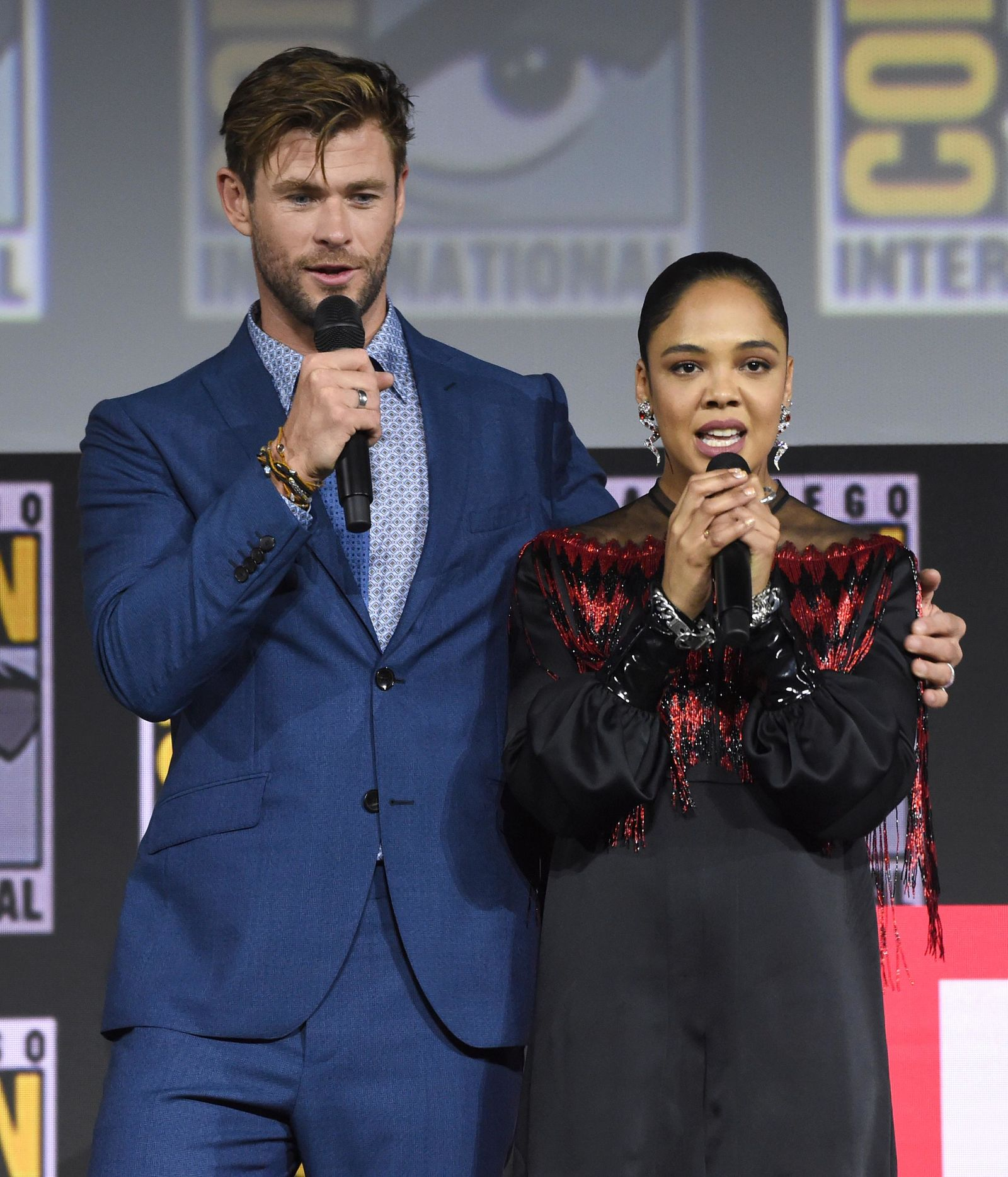"Chris Hemsworth, left, and Tessa Thompson speak during the ""Thor Love And Thunder"" portion of the Marvel Studios panel on day three of Comic-Con International on Saturday, July 20, 2019, in San Diego. (Photo by Chris Pizzello/Invision/AP)"
