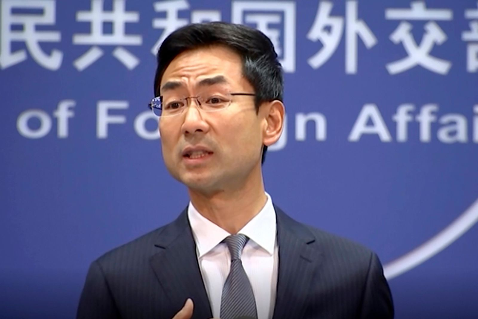 "FILE - In this Wednesday, July 17, 2019 file image from video, Chinese Foreign Ministry spokesman Geng Shuang speaks during a media briefing. China is calling on Washington to ""correct"" sanctions imposed on Chinese companies accused of helping Iran acquire materials for its nuclear program. The foreign ministry spokesman on Friday, July 19, said U.S. pressure on Iran and its ""long-arm jurisdiction"" against companies in third countries is the ""root cause"" of tension with Tehran.(AP Photo/File)"