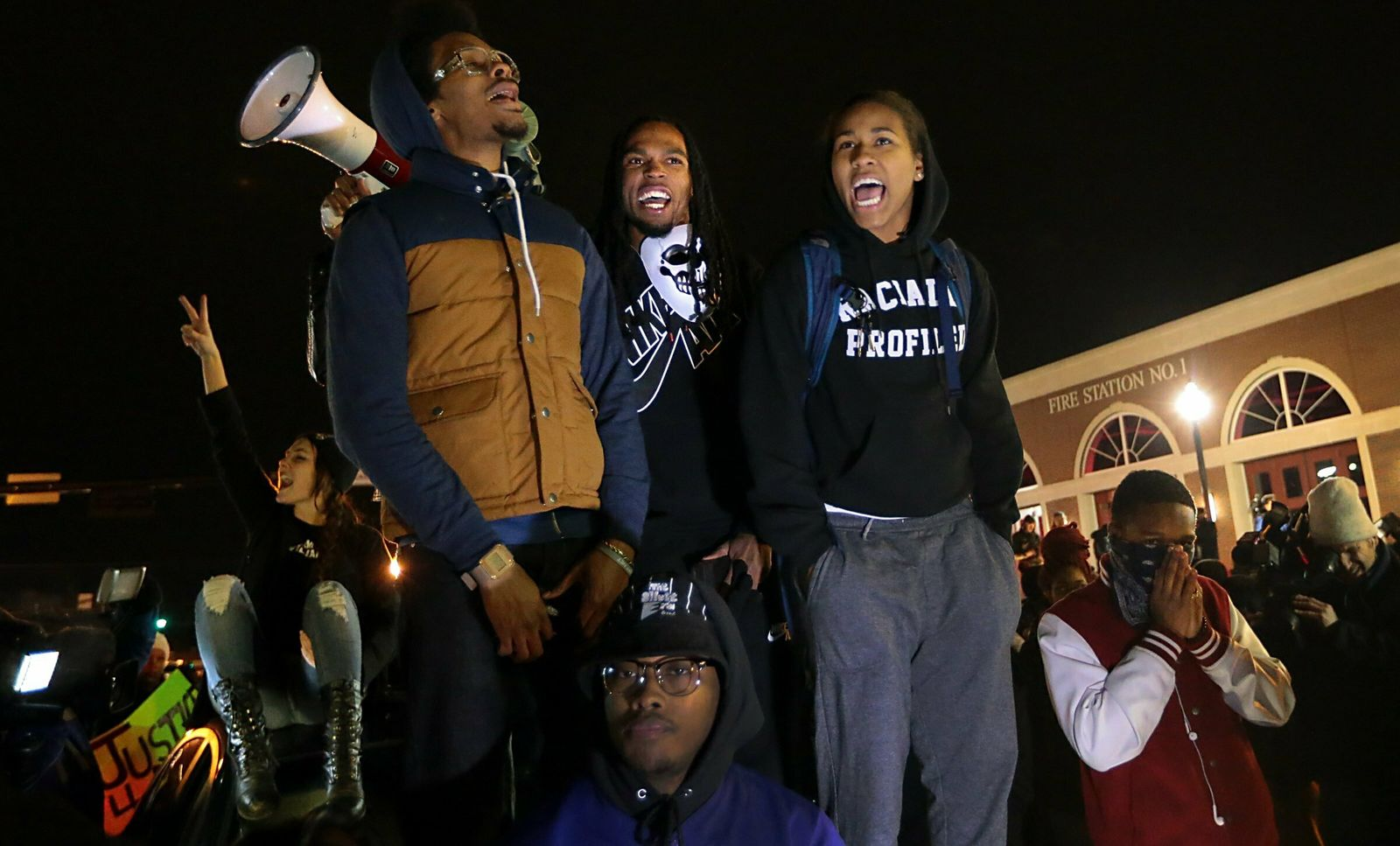 FILE - In this Nov. 24, 2014 file photo, Ferguson activist Daren Seals, top center, awaits the decision by a grand jury on whether to indict Darren Wilson in the death of Michael Brown in front of the police station in Ferguson , Mo.{ } (Robert Cohen/St. Louis Post-Dispatch via AP, File)