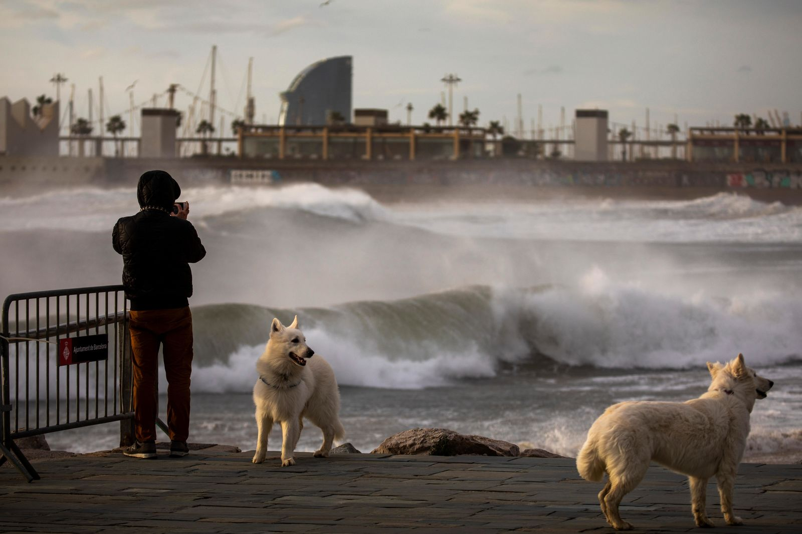 A man photographs the Mediterranean sea during strong winds in Barcelona, Spain, Monday, Jan. 20, 2020.(AP Photo/Emilio Morenatti)