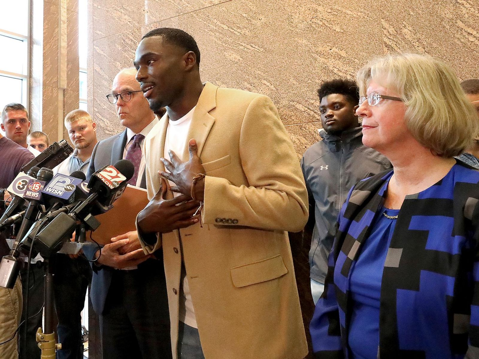 Former Wisconsin Badger football player Quintez Cephus speaks during a press conference to reiterate his request for reinstatement to the university in Madison, Wis. Monday, Aug. 12, 2019. (John Hart/Wisconsin State Journal via AP)