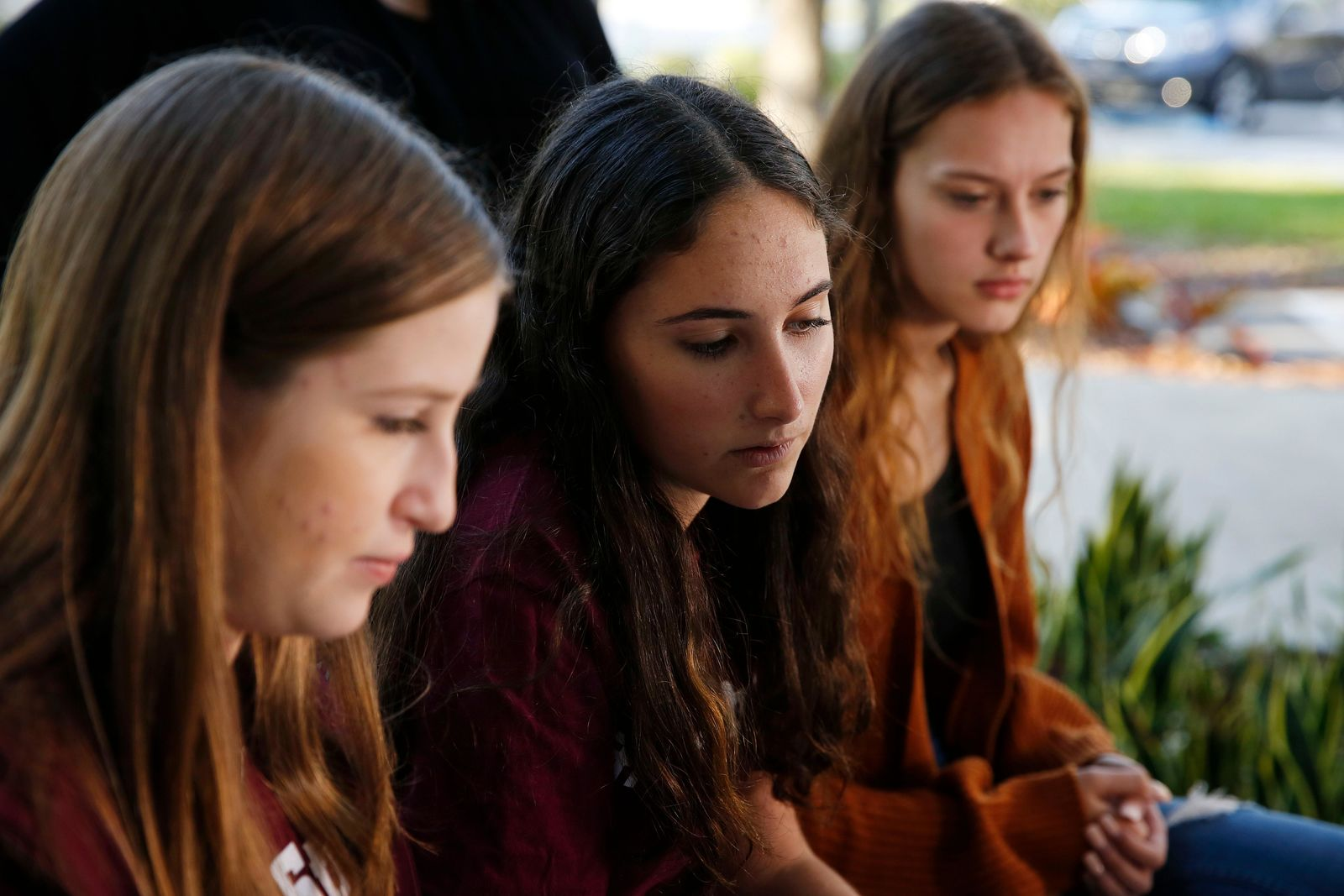 "In this Wednesday, Jan. 16, 2019, photo, Brianna Fisher, 16, left, Leni Steinhardt, 16, center, and Brianna Jesionowski sit during an interview with The Associated Press about a new book called ""Parkland Speaks: Survivors from Marjory Stoneman Douglas Share Their Stories,"" in Parkland, Fla. (AP Photo/Brynn Anderson)"