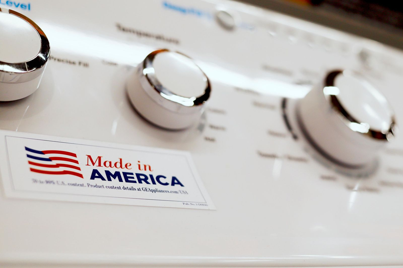 FILE - In this May 9, 2019, file photo a General Electric washing machine with a label advertising it was made in America is displayed in retail stores in Cranberry Township, Pa.(AP Photo/Keith Srakocic, File)